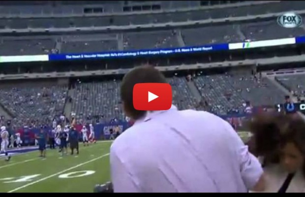 VIDEO: Reporter takes football hit to head